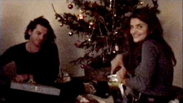 A screen grab from a Hutchence home movie of Michael with model Helena Christensen at his French villa.