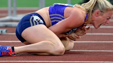 Sally Pearson shouts in pain after hitting a hurdle and tripping in Rome.