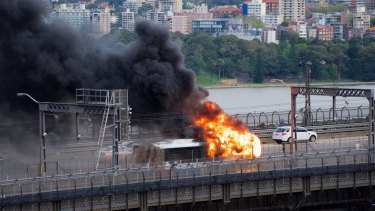Traffic chaos on the Sydney Harbour Bridge as a Sydney Bus catches fire.