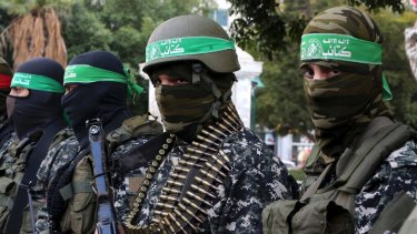 Masked militants from the Izzedine al-Qassam Brigades, a military wing of Hamas.