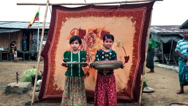 La La, 10, and Noor Bi, 8,  sell fish at the market in the Sin Tet Maw camp for internally displaced persons in Rakhine State, Myanmar.