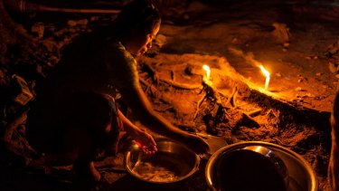 A woman washes dishes at the Phan Khar Kone IDP camp in Bhamo city, Kachin State.