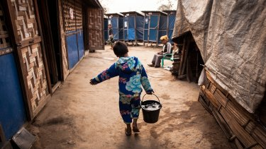Aung Din, 12, displaced from Mung Ding Pa, collects water every morning for his household at the Phan Khar Kone IDP camp in Bhamo city, Kachin State.