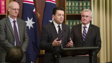 Reverend Tim Costello (left) of the Alliance for Gambling Reform, Senator Nick Xenophon (centre) and Andrew Wilkie MP speak at a press conference outlining their gambling reform agenda for the new parliament on July 14, 2016 in Melbourne.