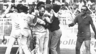 Thrilling finish: Bob Simpson, the only person to have participated in two tied Tests, runs onto the field to congratulate last-over hero Greg Matthews after he had Maninder Singh LBW and tied the 1986 Madras Test.