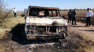 The burnt-out van registered to missing Australian surfer Adam Coleman.
