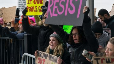 Protesters assemble at John F Kennedy International Airport in New York last week.
