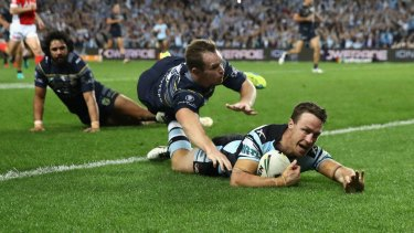King James: James Maloney crosses as the Sharks sealed their place in the grand final with victory over North Queensland.