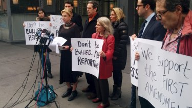 Democratic congresswoman Carolyn Maloney, foreground left, addresses the media in front of the <i>New York Times</i> offices on Saturday, after the newspaper and other media were barred from a Trump administration press briefing.