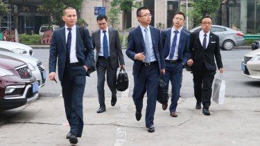 Li Haojun (third from left) lawyer for jailed Crown employee Jason O'Connor arrives at the Baoshan District Court on Monday, flanked by other members of his firm.
