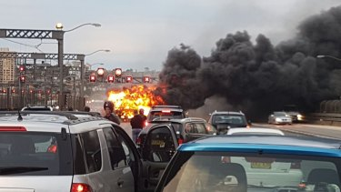 The bus fire brought traffic to a standstill on the bridge.
