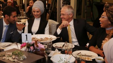 Waleed Aly (left) with his wife, Susan Carland (second left) attend Prime Minister Malcolm Turnbull's 2016 Iftar dinner.