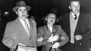 Mrs Petrov being escorted by two Soviet officials onto a plane bound for Russia at Mascot Airport in April, 1954.