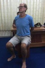 Australian filmmaker James Ricketson in police custody in Phnom Penh.