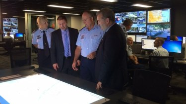 Assistant Commissioner Katarina Carroll, Parliamentary Secretary Josh Frydenberg, Inspector Steve Donnolly from the G20 Group and Queensland Police Minister Jack Dempsey at the $4.5 million G20 Police Operations Centre.