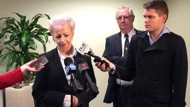 Roseanne Beckett speaks to reporters after her win. Jim McDonogh, a long-time friend and supporter is in the background.