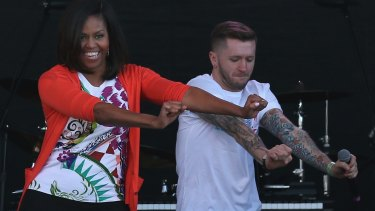 Michelle Obama dances with members of the All Stars from the television show So You Think You Can Dance during the annual White House Easter Egg Roll last year.