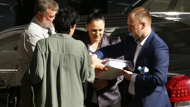 The family of late cricketer Phillip Hughes arrive at the inquest.