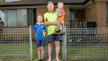 Opposed the pokies plan: David Inverarity and sons Nathan and baby Luke.