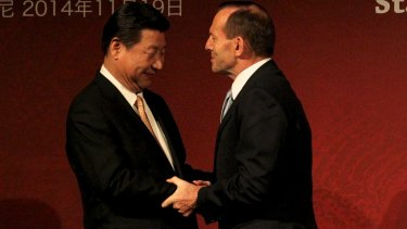 Smells like team spirit: Chinese President Xi Jinping and Prime Minister Tony Abbott at the Australia-China State/Provincial Leaders Forum in Sydney.