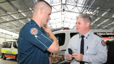 Indigenous-Australian paramedic Dwayne Simpson receives his first-year white stripe from Acting Commissioner Craig Emery.