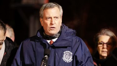 New York City Mayor Bill de Blasio speaks during a news conference after the fire.