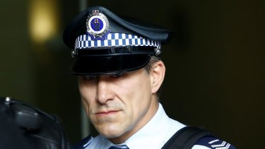 Senior Constable John Wasko leaves the Downing Centre Local Court on Tuesday.