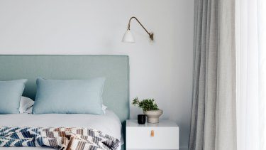 """STYLING TIP: """"Custom fabric-covered headboards add a sense of comfort and opulence often found in luxurious hotels,"""" says interior designer Nina Maya."""