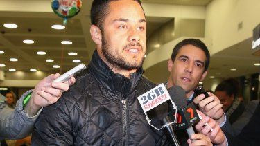 Scrum time: Jarryd Hayne is questioned by waiting media upon arrival at Sydney Airport.