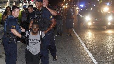 Police arrest activist DeRay McKesson during a protest.