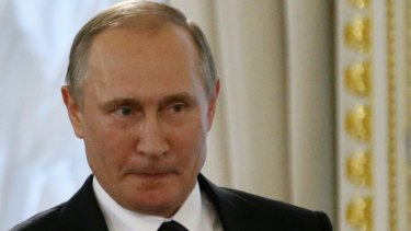 Suppressing a smile: Russian President Vladimir Putin.