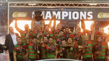 Champions: Captain Greg Inglis lifts the trophy in celebration after the South Sydney Rabbitohs beat St Helens to win the World Club Challenge.