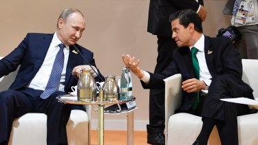Russia's President Vladimir Putin, left, and Mexico's President Enrique Pena Nieto talk at the G-20 summit in Hamburg in July.
