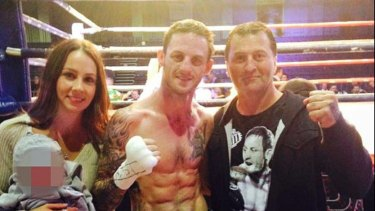 """Boxer David """"Davey"""" Browne with wife Amy and father David Browne snr."""