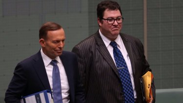 Prime Minister Tony Abbott in Parliament with George Christensen last year.