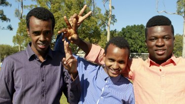 Kuraby resident Abshir Mohamed from Somalia, Inala resident Abdi Muhumed, and Sunnybank resident Mohamed Beauogui at the World Refugee Day celebrations at Annerley.