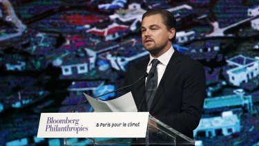 American actor Leonardo DiCaprio delivers a speech during a meeting of mayors from around the world at the Paris city hall on Saturday. The meeting coincided with the UN Climate Conference and carried an environmental theme.