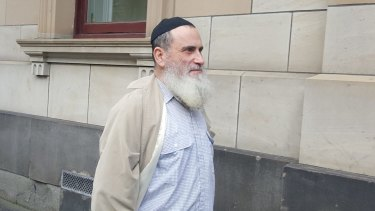 Joseph Gutnick's brother Abraham leaving court on Thursday as he fights a series of eviction notices.