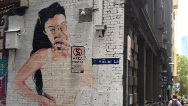 One of the murals painted by street artist Lushsux in Hosier Lane, Melbourne, after council workers censored it on Wednesday morning.