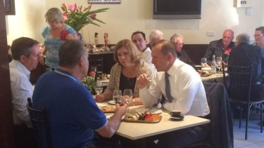 While dining at a coffee shop in Brisbane Mr Abbott said his focus was on budget bills.