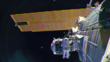 "A sense of urgency: Astronaut Barry ""Butch"" Wilmore on a spacewalk outside the International Space Station in preparation for the arrival in July of the international docking port for the Boeing and Space-X commercial crew vehicles."