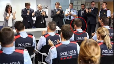 Colleagues burst into spontaneous applause for the officer (circled) at a ceremony.