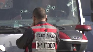 Israeli emergency services personnel at the scene.