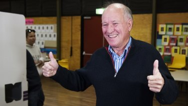Independant candidate for New England, Tony Windsor casts his vote at Werris Creek Public School with his wife Lyn.