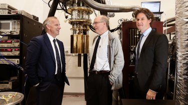 University of Sydney vice-chancellor Michael Spence (left) with Microsoft's Norm Whitaker (centre) and Professor David Reilly in Reilly's laboratory at the Nanoscience Hub.
