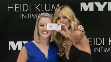Ka-ching: Supermodel Heidi Klum's selfie with a fan in Melbourne last week would likely draw the attention of marketers.