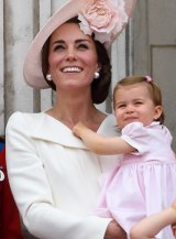 Catherine, Duchess of Cambridge holds daughters Princess Charlotte of Cambridge  in her first appearance on the palace balcony.