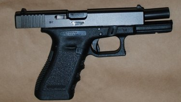 One of two illegal Glock pistols seized by police after searching the teddy bear.