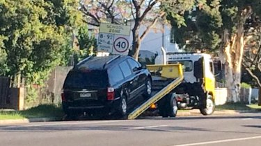 A tow truck arrived just before 6.20pm and the black Kia minivan was loaded onto the tray of the truck before it was towed from the scene.