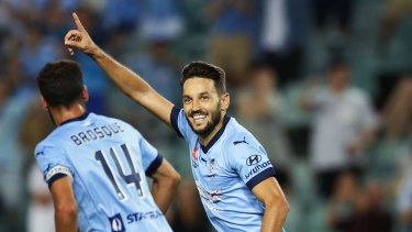 Another one: Milos Ninkovic celebrates with Alex Brosque after scoring a goal against Wellington.